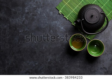 Green japanese tea on stone table. Top view with copy space - stock photo