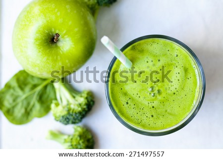 Green juice with broccoli, apple and spinach - stock photo