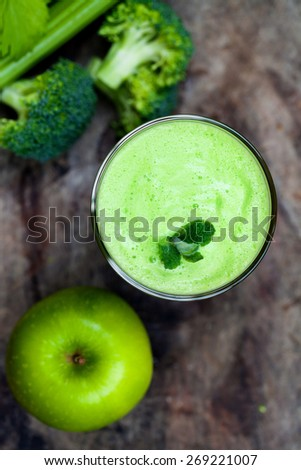 Green juice with broccoli, apples and celery - stock photo