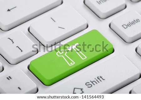 Green key of the computer. The symbol - stock photo