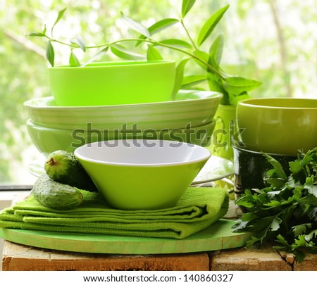 green kitchen utensils on a wooden table - stock photo