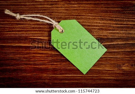 Green label on the wooden background - stock photo