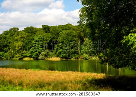 Green Landscape, Lake and Blue Sky in the Park . England, Uk - stock photo