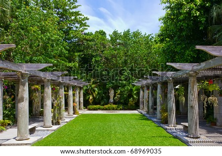 green lawn and covered orchids alleys, Vizcaya Museum & Garden in Miami, Florida - stock photo
