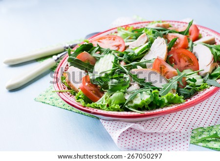 Green leaf salad with vegetables and chicken, close up, selective focus - stock photo