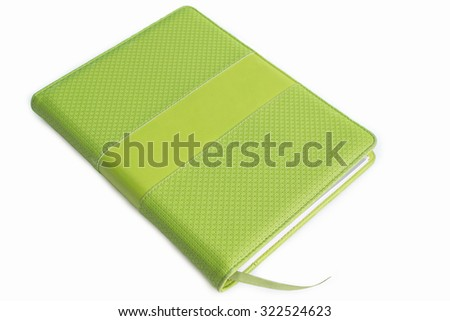 Green leather cover of binder notebook  on white background - stock photo