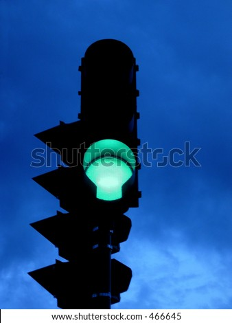 Green light against dark clouds - stock photo