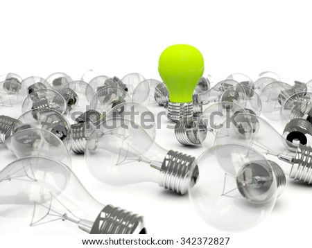 Green light bulb in a pile of bulbs - stock photo
