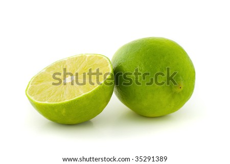 Green lime and its half isolated on white background. - stock photo