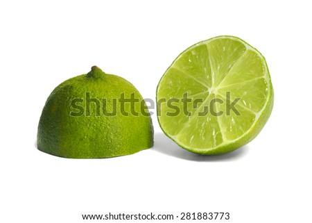 Green lime halves on white background. - stock photo