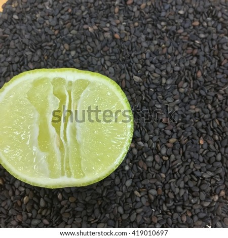 Green lime on black sesame background - stock photo