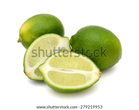 green limes on white background  - stock photo