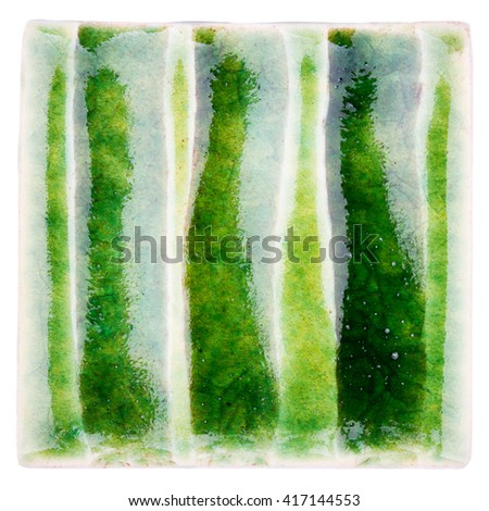 Green lined handmade glazed ceramic tile isolated on white background - stock photo