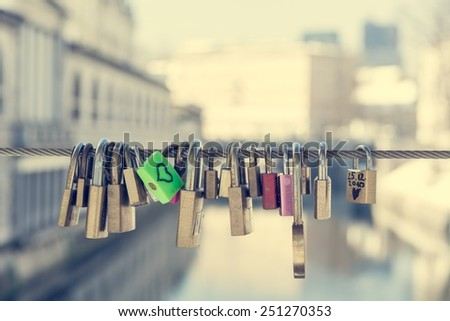 Green love lock over the river - stock photo
