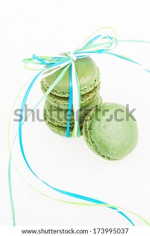 green macaroon tied ribbon on white background - stock photo