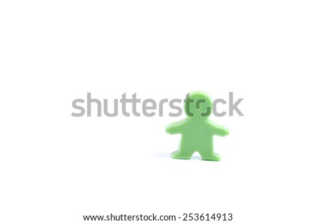 Green man shape magnetic paper clip on white background - stock photo