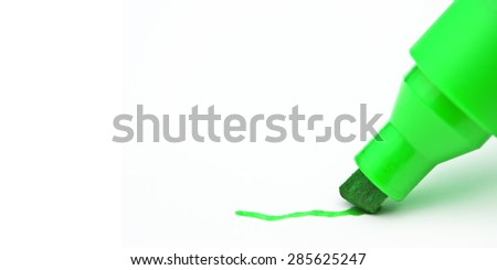 Green marker drawing a line with blank space on the left - stock photo
