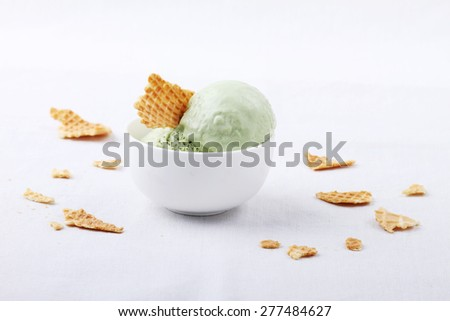 green matcha tea ice cream in white ramekins cup - stock photo