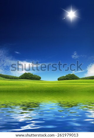 Green Meadow and water reflection. Idyllic Environement concept - stock photo