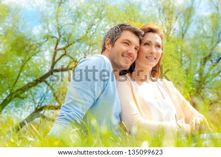 green meadow enjoying outstretched person - stock photo