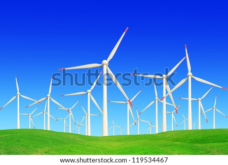 green meadow with Wind turbines generating electricit - stock photo
