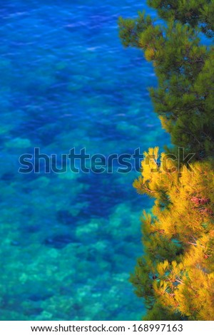 Green Mediterranean vegetation and blue water of Adriatic sea in the background - stock photo