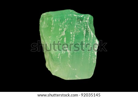 Green mineral calcite on black background. - stock photo