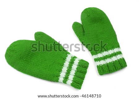 Green mittens with white stripe on wrist over white - stock photo