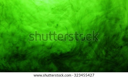 Green mixed into the water. Abstract background - stock photo