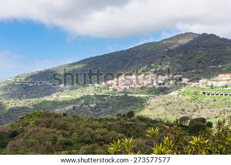 green mountain and Savoca village in Sicily in spring - stock photo