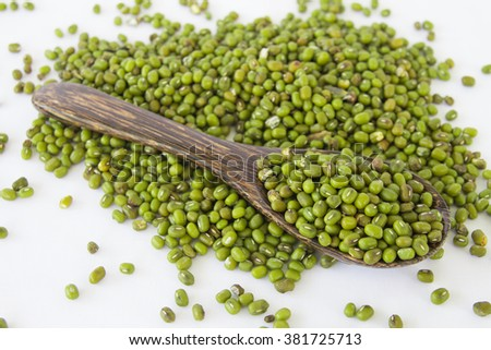 Green mung beans on white background - stock photo