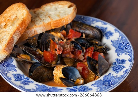 Green Mussels with garlic bread - stock photo