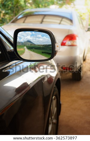 Green nature with road view in Rearview mirror, Landscape in car mirror - stock photo
