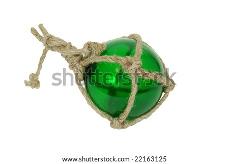 Green nautical glass float tied with rough rope - stock photo