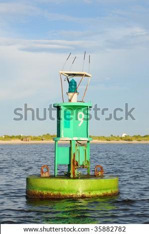 Green Number Nine Buoy Marker Marking Inter-Coastal Waterway - stock photo