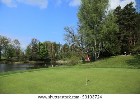 green of a beautiful golf course - stock photo