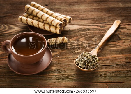 green of tea with  cookies and spoon with green tea - stock photo
