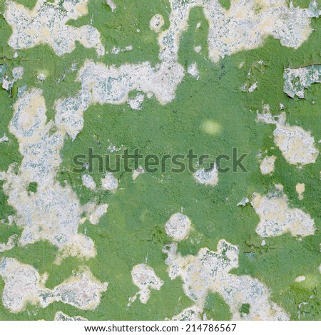Green old damaged paint on a concrete wall - seamless background - stock photo