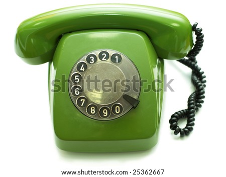 Green old-fashioned telephone on white background - stock photo