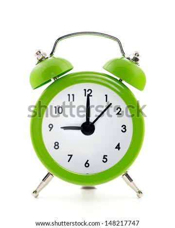 Green  old style alarm clock isolated on white background - stock photo