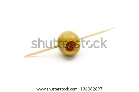 green olive with toothpick isolated on white background - stock photo