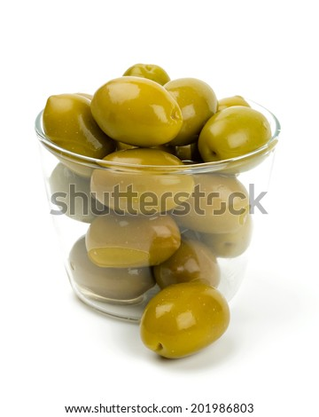 green olives in a glass bowl over white - stock photo