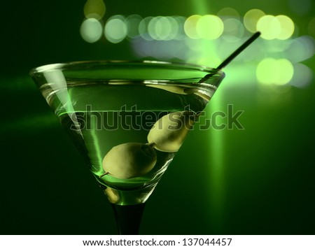 green olives in glass with martini , focus on a olives - stock photo