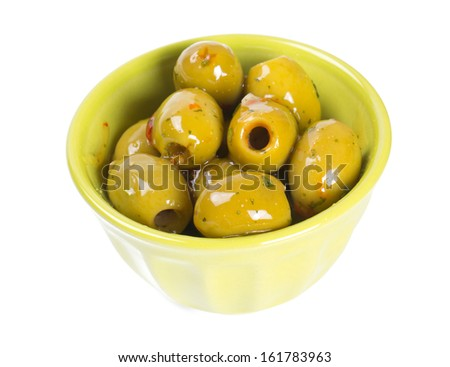 green olives marinated in olive oil and spices - stock photo