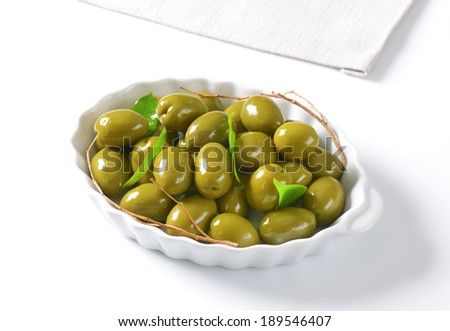 green olives served on the ceramic tray - stock photo