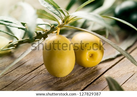 Green olives with leaves - stock photo