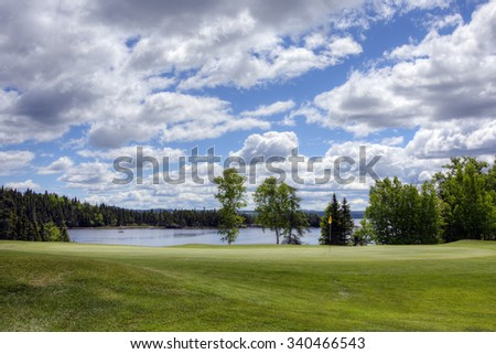 Green on a beautiful golf course. - stock photo