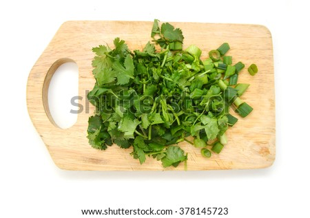 Green Onions on wooden board  - stock photo