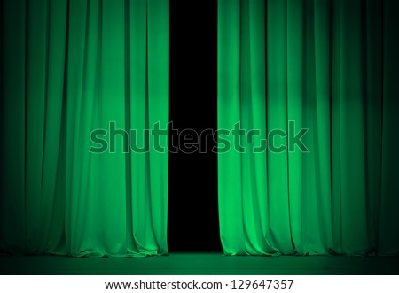 green or emerald curtain on theater or cinema stage slightly open - stock photo