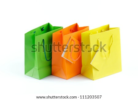 Green, Orange and Yellow Shopping Bags isolated on white background - stock photo